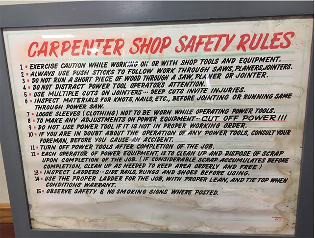 This safety sign—now displayed in the Urton Clock House Museum—would have hung in the Carpenter Shop. Image taken by Research Team